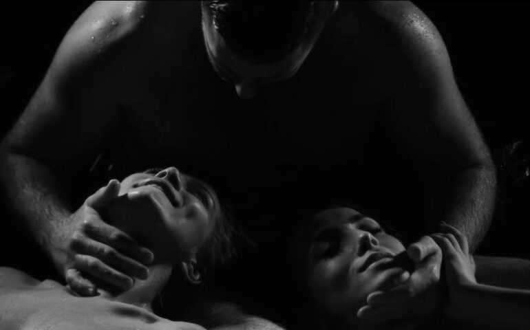 Man caressing two women