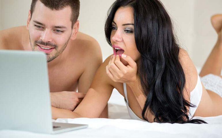 Man and woman watching porn together