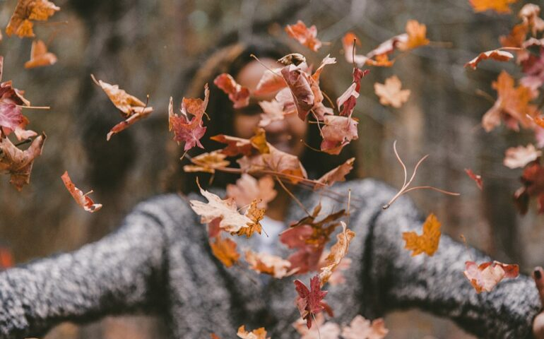 Woman with leaves all over her