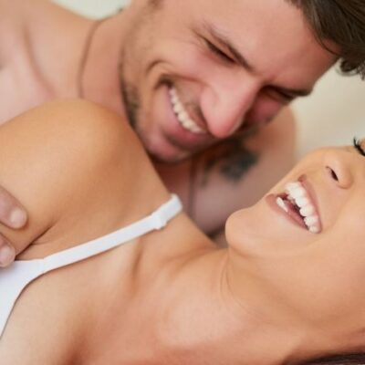 Man and woman happy together in bed