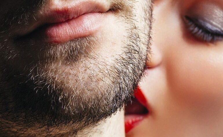 Woman kiss man's neck