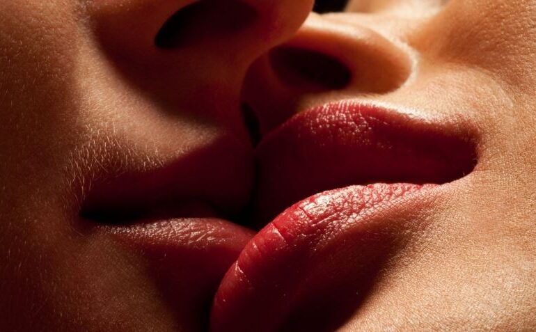 Two kissing mouths