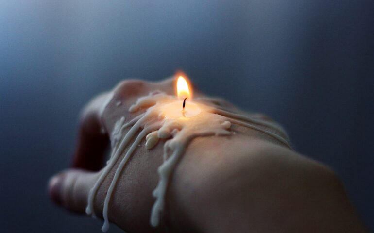 Hand with candle on it