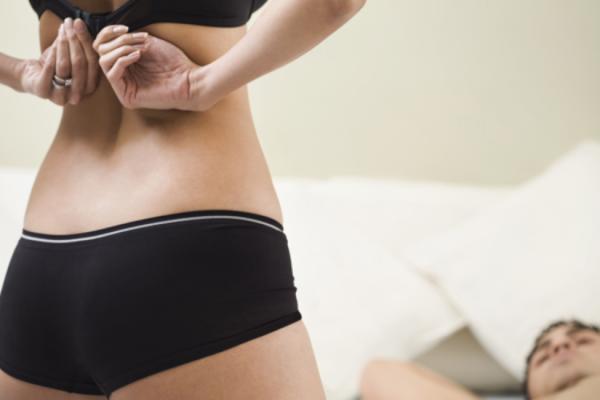 Woman taking off her bra