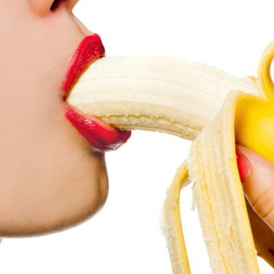 Woman eating a banana