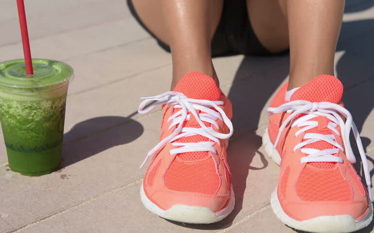 Woman with running shoes and juice